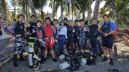 dive team posing in Lomuyon Sarangani